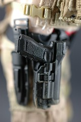 The Shooter in Red: Big-Time Macro Shot (edwick) Tags: woman female actionfigure military ttl turtleneck dcu gerber glock sog kitbash combatboots eotech bodyarmor girlswithguns mk18 16scale sixthscale mark18 chestrig tacticalbabe pmcbaby