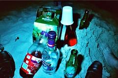 Sandy drinks. (Molosses) Tags: saint heineken lomography sand sardina wine vodka lunaire alcools