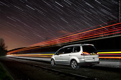 Travel, in space (AndWhyNot) Tags: uk longexposure light sky lightpainting ford field car night truck painting stars star traffic tail wide trails astro lorry galaxy astrophotography streaks taillights startrails stargazing petersfield 0558 urbanstartrail urbanstartrails