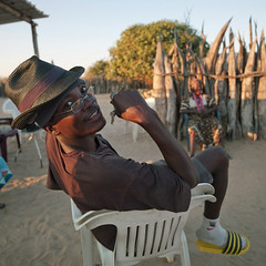Ovambo Preacher On A Plastic Chair, Ruacana Area, Namibia (Eric Lafforgue) Tags: africa wood people man male smile hat fence square outside outdoors person one glasses sitting exterior sandals joy fulllength happiness tribal afrika barrier tribe namibia humanbeing colorphoto southernafrica 296 plasticchair namibie lookingatcamera namibe ruacana squarepicture namibi namiibia westernclothes ethnicgroup ovambo owambo     sittingposition namibya namibio    ruacanaarea owanbo ovambotribe ovambop
