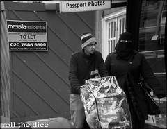 `574 (roll the dice) Tags: life uk winter portrait people urban blackandwhite woman signs black cold london art classic westminster weather fashion shopping shadows veiled veil natural candid headscarf hijab strangers streetphotography busy oil unknown paddington churchstreet niqab odeon burqa unaware marylebone londonist burka nw8 cowl purdah
