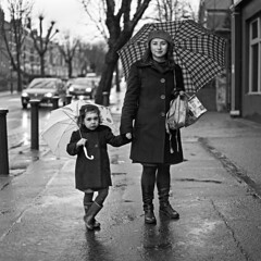 That rainy morning Pt.2 (ted.kozak) Tags: street trees winter portrait cars 120 6x6 girl rain mediumformat square pavement mother rodinal umbrellas fujineopan400 kozak bronicasqa zenzanonps80mmf28 tedkozak tadaskazakevicius