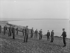 Swordplay (National Library of Ireland on The Commons) Tags: ireland coastguard strand cows sailors beards cliffs moustaches uniforms swords waterford 1905 headland 1900s drilling drills glassnegative tramore rnr backstrand nationallibraryofireland ahpoole poolecollection arthurhenripoole