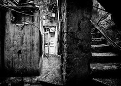 Somebody's home in a maze (Michal Jerabek) Tags: street door light shadow lebanon stilllife home gritty entrace sidon