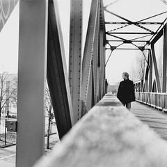 Where is she? I (the bridge) (ikonoblast) Tags: city bridge blackandwhite bw man male love 120 6x6 film analog standing square poetry solitude loneliness steel lubitel2 roll series melancholy searching rollfilm flickraward ilfordhp5120 flickraward5 mygearandme mygearandmepremium dblringexcellence tplringexcellence eltringexcellence