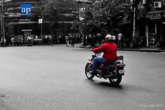 Redding through the Road (ANIRUDDHA PANDEY) Tags: road street red india white black hot monochrome bike nikon biker nikkor kolkata bold avenger