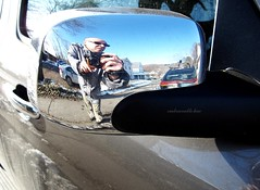 Me, Quite Distorted, on a Chevrolet HHR's Rear Mirror Casing (rafalweb (moved)) Tags: selfportrait reflection cars chevrolet me photoshop self canon mirror reflex shiny metallic rearviewmirror powershot vehicles g12