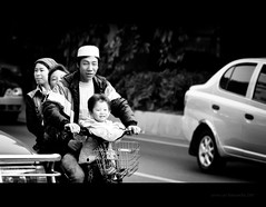 Joyride (PP) Tags: guangzhou china street family people blackandwhite asian parents nikon asia brother candid muslim father joy chinese mother smiles son motorbike bnw chinesefamily d90 streetcandid chinesemuslim nikkor80200mmf28 asianpeople photographystreet nikond90