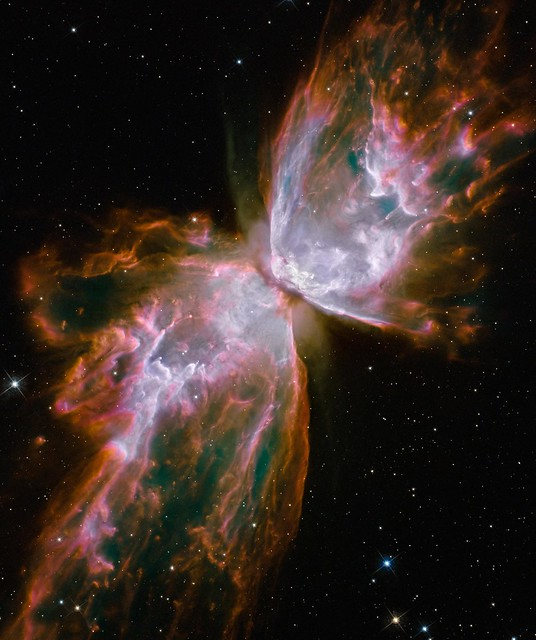 Hubbles New Eyes: Butterfly Emerges from Stellar Demise in Planetary Nebula NGC 6302