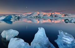 Dormant Giant - Öræfajökull reflected in Jökulsárlón, Iceland (orvaratli) Tags: blue winter sunset moon cold ice landscape iceland melting colorful december floating lagoon glacier arctic iceberg alpenglow jökulsárlón vatnajökull öræfajökull arcticphoto breiðarmerkurjökull
