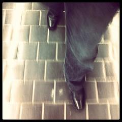 Walkin' (Robert Hruzek) Tags: motion feet walking tile square movement floor boots walk going jeans squareformat brannan stride iphoneography instagramapp uploaded:by=instagram