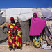 Mother And Two Teenage Girls Outside Slum Hut In Baligubadle Somaliland
