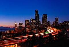Goodbye Seattle (Gabriel Tompkins) Tags: seattle park city longexposure bridge blue light sunset red sky urban usa white blur mountains lines skyline architecture night skyscraper buildings concrete lights washington twilight nikon highway downtown cityscape view skyscrapers traffic i5 dusk horizon scenic trails overpass curvy headlights junction clear explore freeway pacificnorthwest pugetsound bluehour nikkor elliottbay curve washingtonstate 12thavenue pnw streaking wavy i90 emeraldcity 2010 interchange 18105 d90 joserizalbridge columbiacenter explored 18105mm nikond90 joserizalpark 18105mmf3556gvr tronam gabrieltompkins