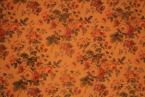 Floral wallpaper on walls and ceiling of back room