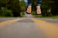I'm flying away ( NoelleBuske ) Tags: road street feet leaving fly flying nikon focus toes dof going gone d40 flipfolps noellebuske