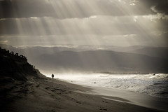 light comes (simone|cento) Tags: morning winter light sea sun man beach walking coast sand wind human 7d presence