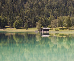 Hut at the Hintersteinersee (GavinKing) Tags: blue trees lake alps green canon eos austria ngc tranquility hut tyrol refelctions peacefull 50d lakehut gentechnikfrei organicandgmofreeworld hintersteinesee