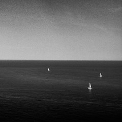 IMG_0727b (quiet rush) (ikonoblast) Tags: light sea summer sky blackandwhite bw black water contrast square freedom boat moving ancient solitude mood sailing ship loneliness peace angle nowhere wide perspective peaceful wave pointofview silence simplicity minimalism schwarzweiss vastness endless scharzweiss blackwhitephotos mygearandme