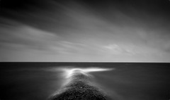 --/\-- (Jurjen Harmsma Photography) Tags: longexposure winter sky bw lake storm nature water netherlands architecture clouds canon movement europe waves seascapes tide horizon lakes nederland pole simplicity poles friesland 2012 airscapes bw110 eos1000d