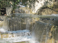 Stone Waterfalls in the Park (shaire productions) Tags: park urban nature water fountain garden flow outdoors photo stream image photograph manmade setting watery