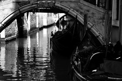 It's Siesta Time!!! (Seth Oliver Photographic Art) Tags: venice blackandwhite bw italy monochrome reflections nikon europe silhouettes cityscapes cropped naptime pinoy travelphotography d90 footbridges wetreflections handheldshot siestatime canalsofvenice venetiangondolas medievalcities aperturef90 iso159 europeantravels manualmodeexposure setholiver1 bnwconversion 18105mmnikkorlens circularpolarizers venetiangondoliers 1125secondexposure