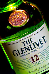 Glenlivet 12 Year Old Single Malt Scotch Whisky (NJRC) Tags: camera green canon bottle glow flash off liquor single whisky scotch 12 xsi 430 malt glenlivet exii