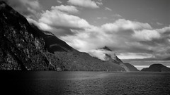 Clouds Over a Peaceful Fiord (Timothy Hunter) Tags: newzealand blackandwhite bw mountains nature clouds contrast landscape scenery samsung nz fiord doubtfulsound fiordlands