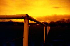 Pitch (Saturated Imagery) Tags: red silhouette 35mm fire iso200 epson praktica v500 filmslr vivitar28mmf25 prakticatl5b lomographyredscalexr devlopedthephotoshop