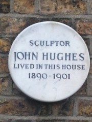 Photo of John Hughes white plaque