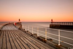Still. (tricky (rick harrison)) Tags: ocean uk pink sea orange composition sunrise pier unitedkingdom yorkshire whitby northyorkshire leadinglines nd10 longenposure