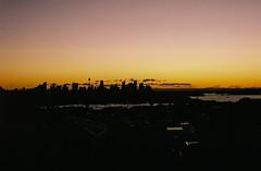000014 (jayolz) Tags: city sunset film skyline 35mm sydney olympus goldenhour fujisuperia fujisuperiaxtra400 olympus35sp 35sp