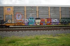 ? (TheGraffitiHunters) Tags: auto street blue red orange white black art car train graffiti eyes colorful paint purple faces tracks spray rack superhero carrier freight autorack benched benching 517393 sp517393