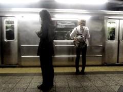 PAIR SUBWAY B&W (bill sweeney4) Tags: nyc newyorkcity urban woman newyork blur girl car station train underground subway movement waiting couple metro platform motionblur transportation transit commute lightanddark stillfiguremovigtrain stillfigure