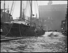 T-wharf flooded from storm, M.M. Hamilton docked, 2 masted wooden ship (Boston Public Library) Tags: weather storms floods lesliejones