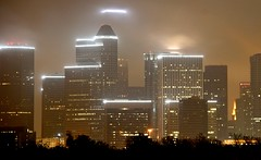 Stormy Houston Skyline (J-a-x) Tags: city urban usa storm weather fog skyline architecture night clouds buildings lights downtown cityscape texas skyscrapers cloudy foggy houston canonefs18200mmf3556is