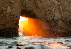 fire in the hole (Andy Kennelly) Tags: california door bridge light wild seascape beach wet landscape fire one 1 coast big highway rocks ray glow arch hole natural fireworks beam textures doorway sur portal rays rough splash rugged pfeiffer forpatrick