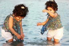 Double Shamsa (Hazel Eyes ) Tags: family sea portrait baby water girl sunshine dubai uae cousin waterdrops shamsa palmjumeirah