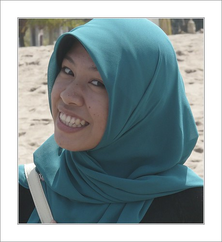 Girl in blue hijab .