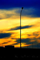 The Great Street Light! ***[EXPLORED]*** (Haryth Hayqal) Tags: lighting light sunset shadow cloud sun building nature silhouette night streetlight pole
