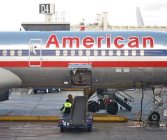 Flying American (jurvetson) Tags: playing airplane airport florida miami cargo american mia airlines caught hold banklrupt