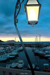Porto al tramonto burrascoso (MrMassori) Tags: canon tramonto barche porto sicilia lampione porticciolo capozafferano sannicolalarena canon550d