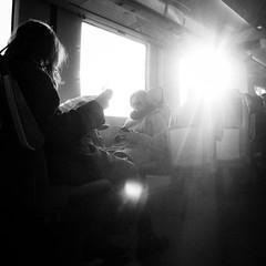Lens flare haven II (Klardrommar) Tags: travel people bw white black monochrome digital train lens sweden flare gr sverige malmö ricoh pågatåg skånetrafiken grdii