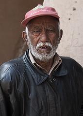 Follow the leader now! (viralstile) Tags: poverty old pakistan portrait tourism asia poor explore portraiture guide punjab oldpeople lahore tourguide lahorefort shahiqila canonef50mmf14usm touristguide canoneos500d canoneosrebelt1i canoneoskissx3 povertyinpakistan viralstile