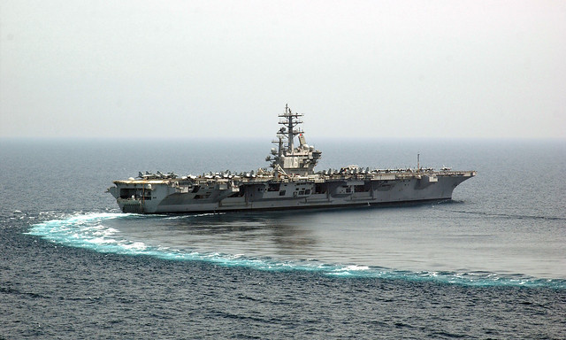 Arabian Gulf - April 14, 2006. 97,000 tons never turned so easily.  USS Ronald Reagan (CVN 76) comes about after she has completed another cycle of flight operations in the Arabian Gulf.