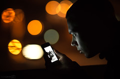 checking low light (Dongringo) Tags: light portrait orange selfportrait black night zeiss dark focus dof nightshot minolta bokeh sony alpha za slt 135mm selfie x700 a55 sal135f18z sonnart18135 slta55v sonyalphadslta55