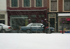 First snow (dtepas) Tags: city people white snow holland netherlands bicycle canon eos day wind sneeuw nederland denhaag february wit fiets februari flickrhivemindgroup