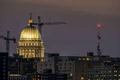 Capitol and cranes (speedcenter2001) Tags: skyline wisconsin night capitol madison dome isthmus nikon600mmf40edifais