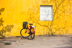 Bicycle (Gigin - NoDigital) Tags: shadow tree nature colors bicycle yellow wall buildings other asia parts objects an vietnam hoian transportation geography hoi locations vn qungnam tphian