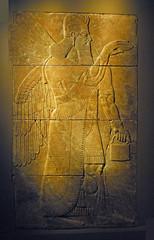 AssyrianPano01 (Grudnick) Tags: wall iraq palace relief genius cuneiform deity assyrian nimrud magicpotion neoassyrian kingashurnasirpalii benevolentspirit wingedspirit hornedcrown