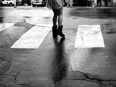 Oblivion (Professor Bop) Tags: street bw woman monochrome lines rain female legs boots pavement crosswalk bellowsfallsvermont drjazz professorbop olympuse5